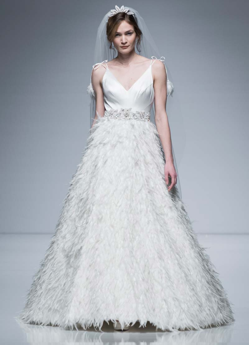 Designer wedding dress with feathered skirt