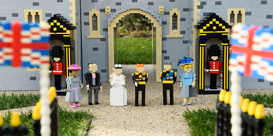 Prince Harry and Meghan Markle's LEGO Windsor Castle Model with LEGO Charles and Camilla and Meghan Markle's LEGO Parents as well as LEGO Foot Guards and LEGO Union Jack Flags | Confetti.co.uk