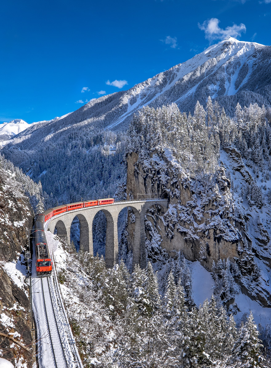 Best Honeymoon Destinations for Winter Weddings - Switzerland Honeymoon Ideas - Glacier Express Train Tour with Jungfrau Mountain in Winter by Alessandro Colle on Shutterstock | Confetti.co.uk