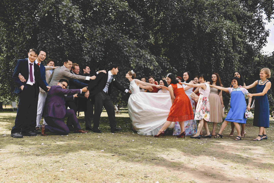 Funny Wedding Photo - Tearing the Bride and Groom Away From Each Other by Emma-Jane Photography | Confetti.co.uk