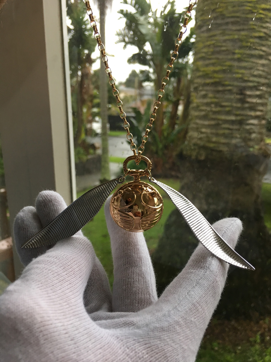 Harry Potter Wedding Ideas - Golden Snitch Ring Box and Necklace from Freeman Design | Confetti.co.uk