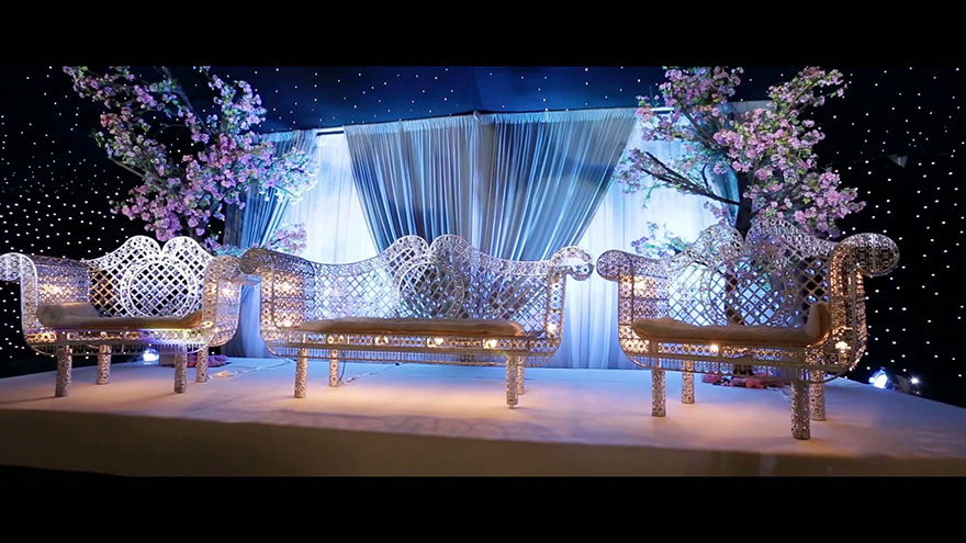 Newland Manor Civil and Asian Wedding Venue in Buckinghamshire - Cinematic Highlights of Faraaz and Sofia Wedding at Newland Manor from Image UK Photography - Lit Up Couple's Throne with Trees and Drapes - Stunning Wedding Lighting Ideas | Confetti.co.uk
