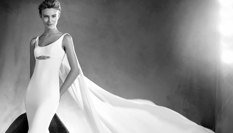 Superhero Wedding Dress - Edurne by Pronovias Atelier - Simple and Beautiful Mermaid Wedding Dress with Round Neckline, Thin Straps, Long Fluid Cape and Gemstone Details - Wedding Dresses with Capes Thumbnail | Confetti.co.uk