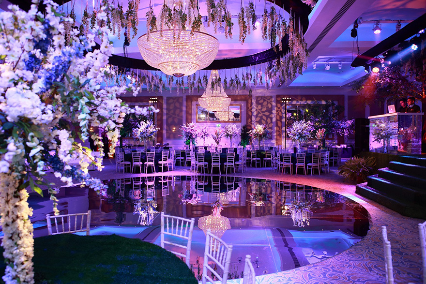 Vibrant Meridian Grand Ballroom Banquet Hall and Wedding Reception Room with Hanging Flowers and Central Wedding Reception Dance Floor | Confetti.co.uk