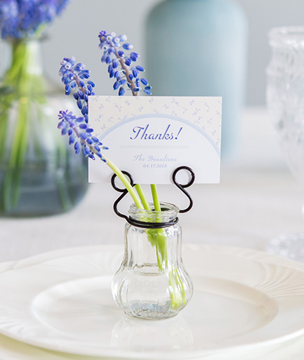 Bluebells Wedding Stationery - Vintage Blue Name Cards in a Decorative Glass Vase with Flowers - Pretty Blue Wedding Ideas | Confetti.co.uk