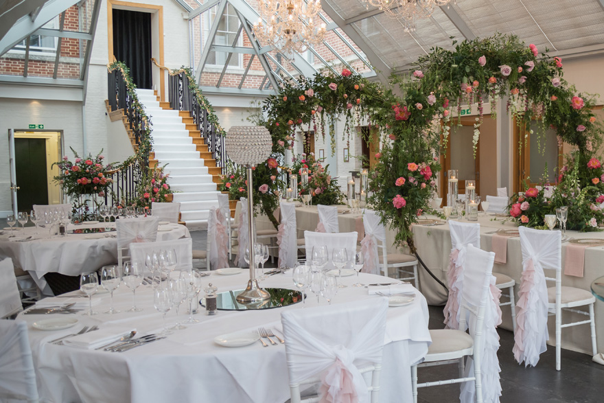 Botleys Mansion Glass-Roofed Atrium - Stairs Wedding Aisle - Creative Wedding Venue Decor | Confetti.co.uk