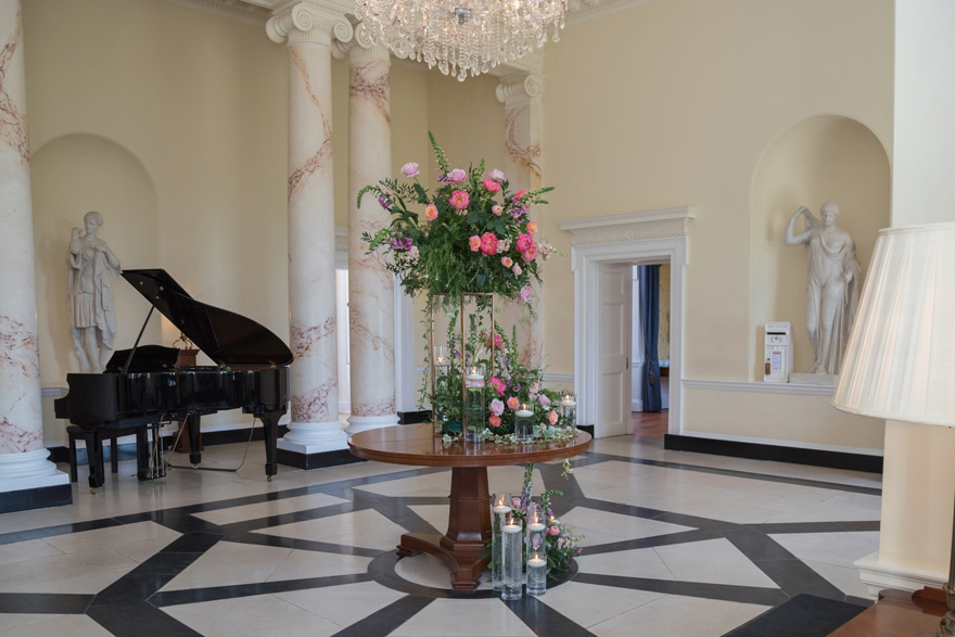 Botleys Mansion Marble Room with Marble Columns and Statues - Grand Piana Room - Summer Floral Centrepiece | Confetti.co.uk