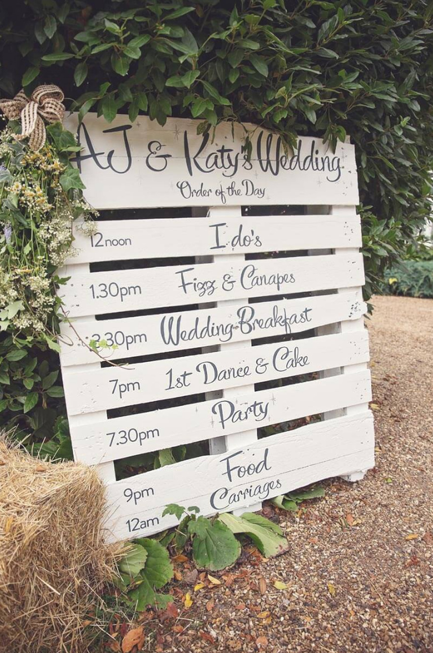 Marquee Wedding from Energy Photographic - Wedding Timeline Sign Ideas - Best Wedding Signs - Pallet Wedding Sign - DIY Wedding Signs - Order of the Day Wedding Ideas | Confetti.co.uk