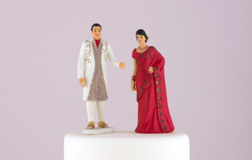 Traditional Indian Bride in Red Sari and Traditional Indian Groom Figurine Cake Toppers | Confetti.co.uk