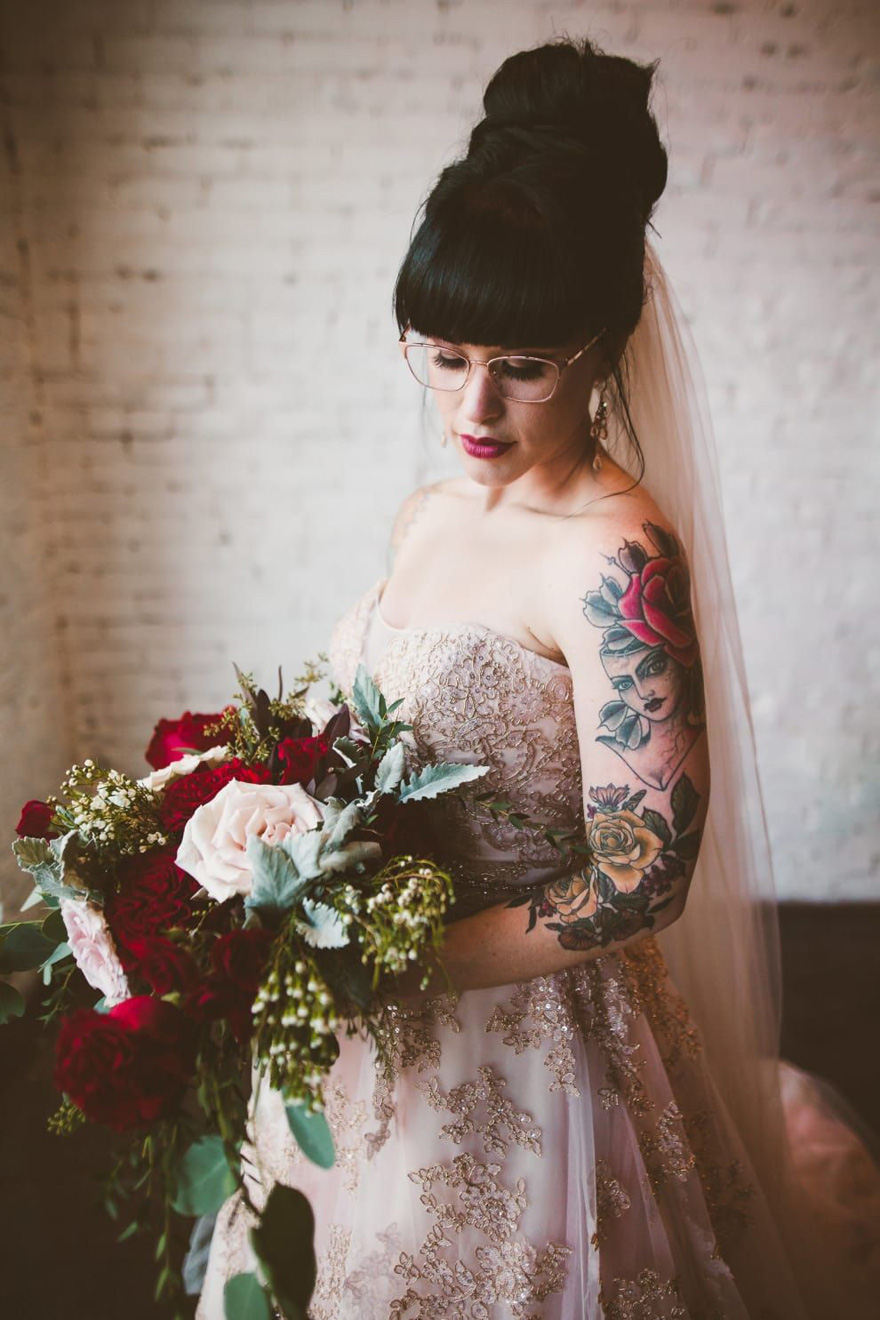 Bride with Rose Arm Tattoos - Bride Holding a Bouquet - Megan and Steve Lakeland Florida Wedding by Savannah Lauren Photo | Confetti.co.uk