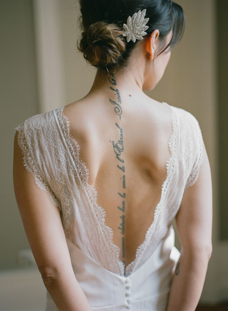 Bride with Spine Tattoo by Greg Finck Photography - Script Tattoo Along the Spine - Vintage Wedding - Elegant Tattoo Ideas - Brides with Tattoos | Confetti.co.uk