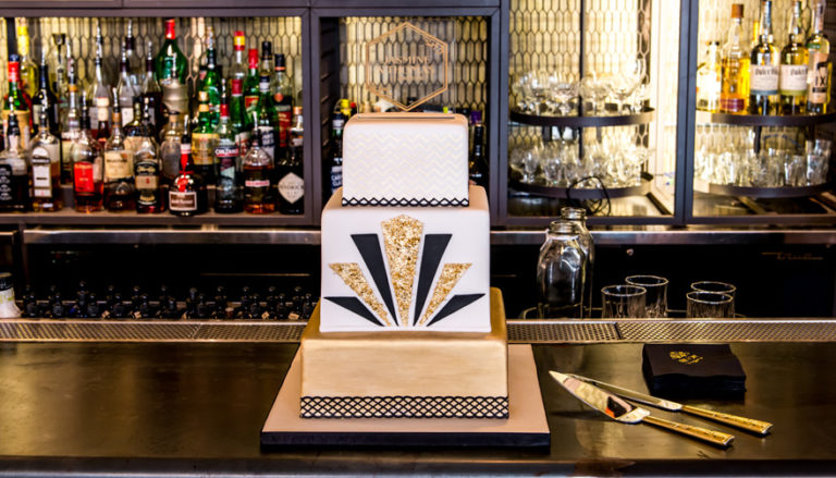 13 Stunning Metallic Wedding Cakes - Black and Gold Square Art Deco Cake | Confetti.co.uk