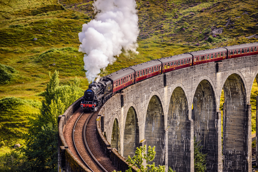Glenfinnan Railway Viaduct in Scotland with the Jacobite Steam Train Passing Over by Nick Fox on Shutterstock - Hogwarts Express Harry Potter Wedding Ideas | Confetti.co.uk