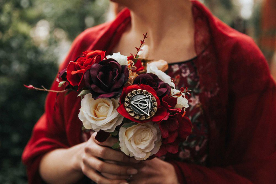 Harry Potter Bridal Bouquet Ideas - Alex and Matt's Harry Potter Wedding by Maddie Farris Photography - Deathly Hallows Symbol Charm | Confetti.co.uk