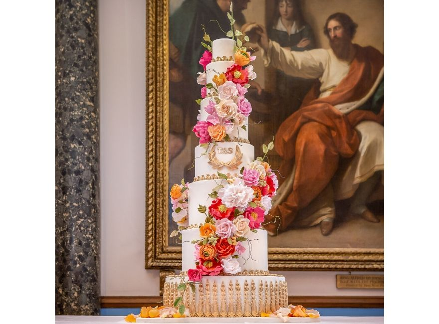 Six tiered wedding cake with flowers