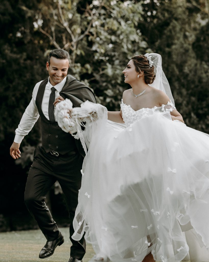 Bride and groom dancing to upbeat first dance song
